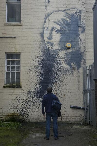 A defaced piece of graffiti art by Banksy (Ben Birchall/PA)