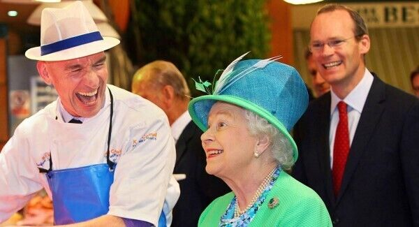 Fishmonger Pat O'Connell and Queen Elizabeth II during her visit to the English Market in 2011