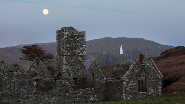 Full moon rising over Sherkin Island's Franciscan Abbey on April 7th, with Baltimore Beacon in the distance. Picture: Robbie Murphy