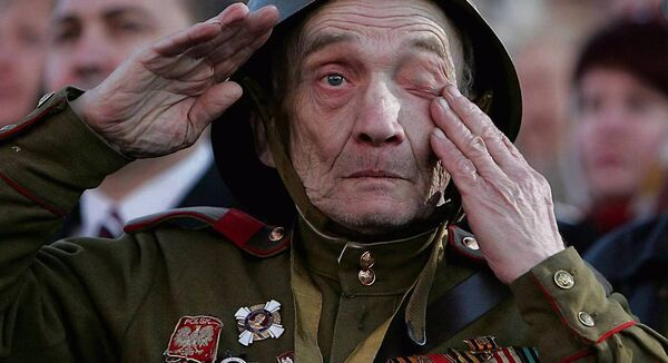 An elderly man dressed in a military uniform of the WWII Red Army cries at the Red Square in Moscow, 09 May 2007, during the annual celebration of the end of World War II. Pic: AFP/Maxim Marmur
