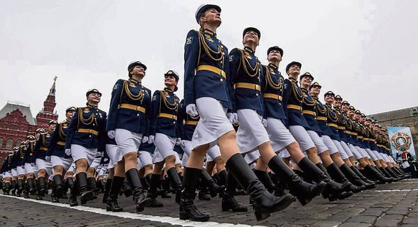 Russian servicewomen march through Red Square during the Victory Day military parade in downtown Moscow on May 9, 2019. Pic: Mladen Antonov/AFP via Getty Images