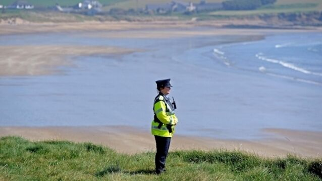 Garda Noelle O'Dwyer, community garda, Ballinspittle, Co. Cork, on duty at a very quiet Garrylucas beach, Co. Cork, on Easter Saturday afternoon during the current Covid-19 restrictions. Picture Denis Minihane.