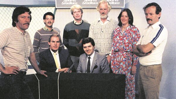 The 'Sports Stadium' team from 1985. Presenters Noel Reid (left) and George Hamilton are seated. Standing (L-R); Max Mulvihill (producer), Stephen Alkin (producer), Mike Horgan (editor), Brian McSharry (editor and commentator), Patricia Murphy (producer), Maurice Reidy (editor). Picture courtesy RTE Stills Library.