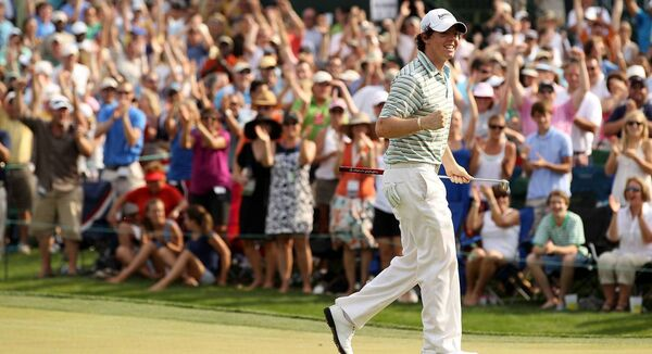 Rory McIlroy of Northern Ireland reacts to making a birdie on the 18th green during the final round on his way to winning the Quail Hollow Championship at Quail Hollow Country Club on May 2, 2010 in Charlotte, North Carolina. (Photo by Streeter Lecka/Getty Images)