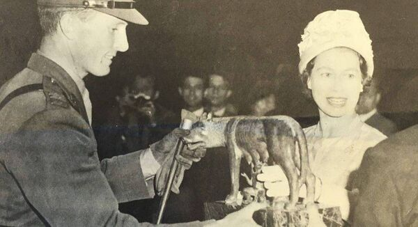 Queen Elizabeth II presents the Romulus & Remus trophy to Captain Billy Ringrose on winning the Grand Prix at the Piazza di Siena, Rome, with Loch an Easpaig. Ringrose also came second on his back-up horse, Cloyne. Photo from 'Billy Ringrose – A memoir of my Father'.