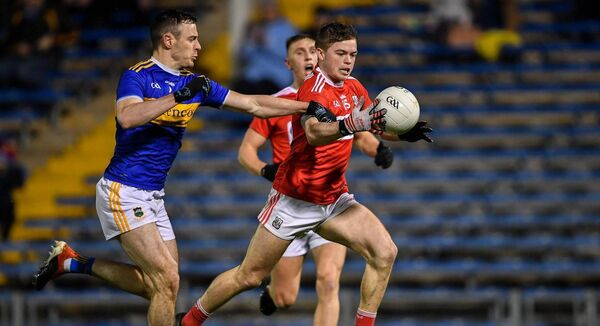 Cathail O'Mahony of Cork in action against Tipperary's Alan Campbell last month at Semple Stadium. Photo by Piaras Ó Mídheach/Sportsfile