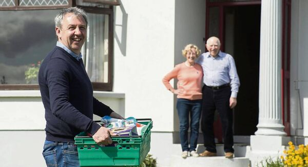TEAM EFFORT: Kerry football manager and SuperValu owner Peter Keane on his daily delivery rounds dropping off messages to Willie and Kathleen Fitzgerald at home in Killorglin. 'Your GAA clubs are working with your SuperValus and with councils and the Gardaí and they are basically getting around to the people, delivering a bit of a prescription or a bit of shopping or whatever,' says the Kerry boss.  	Picture: Don MacMonagle