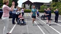 Cork school physio to run a carpark marathon to raise money for a special bus