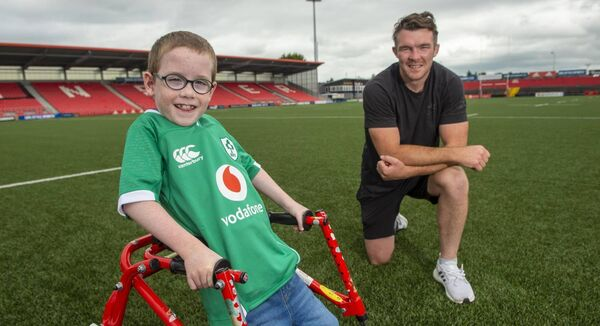 Ireland and Munster rugby player Peter O'Mahony met up with eight-year-old Oliver Lynch at Musgrave Park, Cork while he was doing his 100m walk to raise money for Cork charities. Picture: Dan Linehan