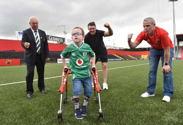 President of the IRFU Nicky Comyn, Ireland and Munster rugby player Peter O'Mahony and Kevin Lynch with eight-year-old Oliver Lynch at Musgrave Park, Cork who was doing his 100m walk to raise money for Cork charities.   Picture Dan Linehan