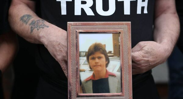 Eugene Kelly, holds a photo of his 17-year-old brother Robert who died in the 1981 Stardust fire. Picture: Niall Carson/PA Wire