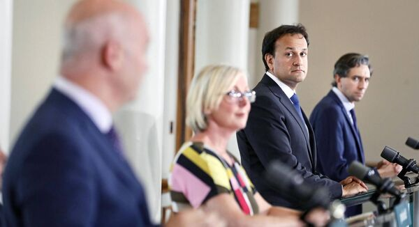 Regina Doherty with Tony Holohan, Leo Varadkar and Simon Harris at a press briefing in Dublin Castle. Picture: Julien Behal