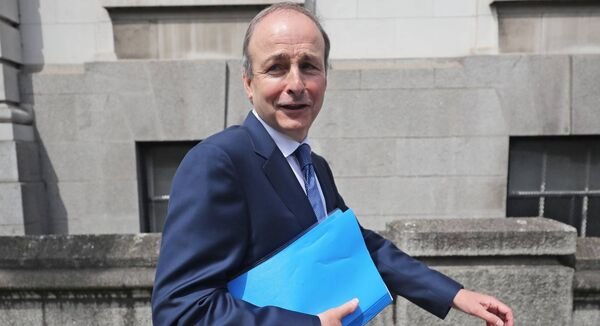 Fianna Fail leader Micheal Martin who is set to become the next Taoiseach, outside Government Buildings in Dublin, after Fianna Fail, Fine Gael and the Greens finalised the text of a draft programme for government four months on from the election. (Niall Carson/PA Wire)