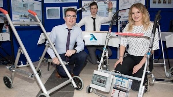 Students Cian O'Leary, Kevin Hayes, and Muireann Hickey with their mobility aid to assist users stand from a seated position. Photo: Darragh Kane