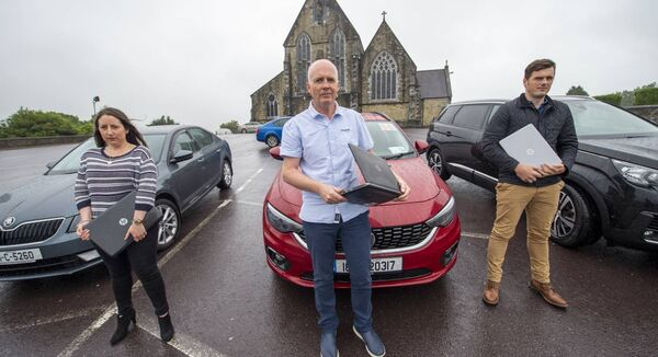 James O'Regan, Maeve O'Sullivan-Kennedy, and Tony Cullinane who work from home are all residents of Gaggin, West Cork which has no internet service.  They travel into St. Patrick's Church car park in Bandon every day to receive a broadband signal. Picture Dan Linehan