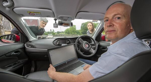 James O'Regan, Maeve O'Sullivan-Kennedy and Tony Cullinane who work from home are all residents of Gaggin, West Cork which has no internet service. They travel into St. Patrick's Church car park in Bandon every day to receive a broadband signal. Picture Dan Linehan