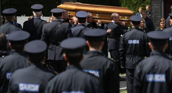 The coffin of Detective Garda Colm Horkan is carried from St James' church to the cemetery in Charlestown, Co Mayo. Picture: Brian Lawless/PA Wire