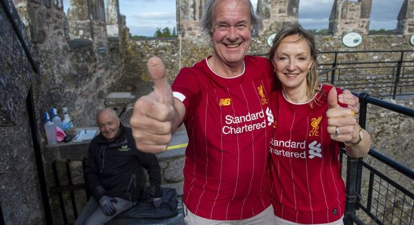 Charles and Caroline Colthurst who both wore Liverpool shirts and kissed the Blarney Stone to mark the reopening of Blarney Castle to the public. Pictures: Dan Linehan