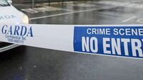 Man arrested after woman shot in Ballymun