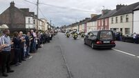 Ballaghaderreen stands in silent tribute to slain garda, Colm Horkan