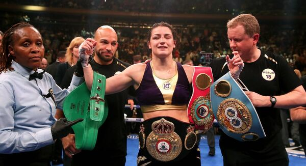 Katie Taylor (centre) celebrates her win against Delfine Persoon in the IBF, WBC, WBO, WBA, Ring Magazine Women's Lightweight World Championships fight at Madison Square Garden, New York.