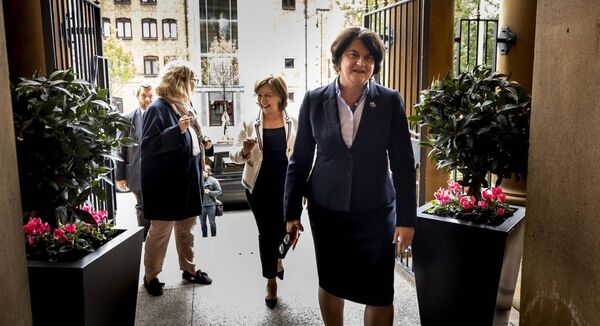 Northern Ireland First Minister Arlene Foster (right) and Northern Ireland Economy Minister Diane Dodds (centre) after a press conference outside the Merchant Hotel. Picture: Liam McBurney/PA Wire