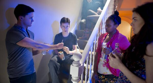 young teenage boy gets offered cannabis joint at a house party..