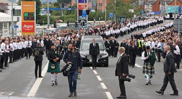 The funeral procession of senior Irish Republican and former leading IRA figure Bobby Storey following the funeral at St Agnes' Church in west Belfast.