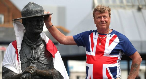 Locals show their support for a statue of Robert Baden-Powell on Poole Quay in Dorset today. Pic: Andrew Matthews/PA