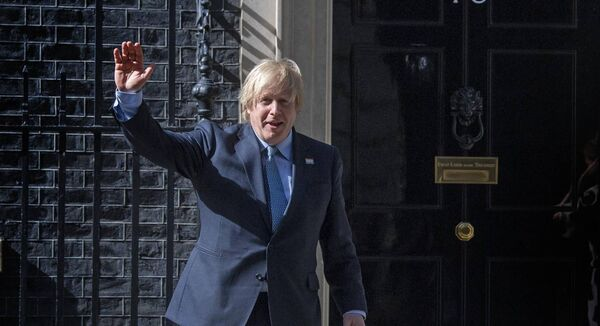 As part of the NHS birthday celebrations, Prime Minister Boris Johnson waves after joining in the pause for applause to salute the NHS 72nd birthday outside 10 Downing Street, London. Picture: Victoria Jones/PA Wire