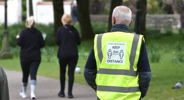 A Cork City Council park warden keeping an eye on social distance at the Lough, Cork. Picture: Dan Linehan