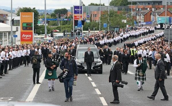 The funeral procession in west Belfast (Liam McBurney/PA)