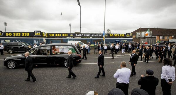 The coffin of senior Irish Republican and former leading IRA figure Bobby Storey passes Casement Park in west Belfast following the funeral at St Agnes' Church.