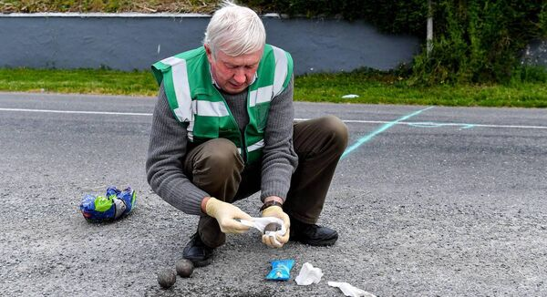Willie Murphy, Treasurer of the North Cork Region, and uncle of former Cork ladies footballer Juliet Murphy, cleans the bowls with sanitising wipes before the match between Shane Dennehy of Bweeng and Donncha Spillane of Ballinagree. Picture: Piaras Ó Mídheach/Sportsfile