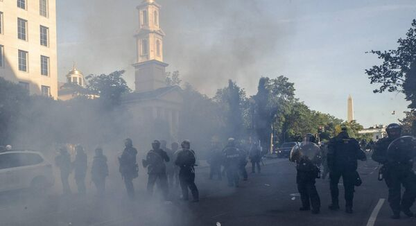 Police move demonstrators away from St. John's Church across Lafayette Park from the White House. The US Attorney General William Barr promised a crackdown on members of the anti-fascist movement known as antifa. Picture: AP