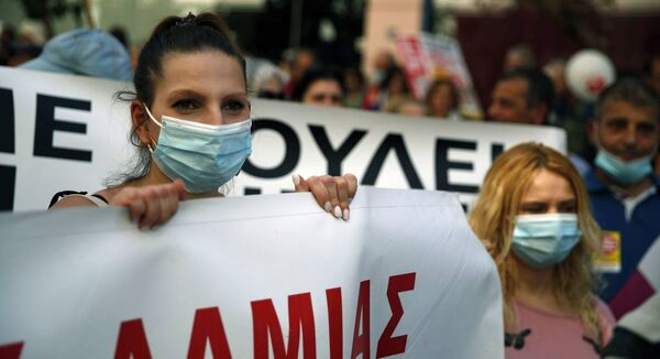 A nurse takes part in a rally outside the Health Ministry in Athens last month. Picture: Thanassis Stavrakis