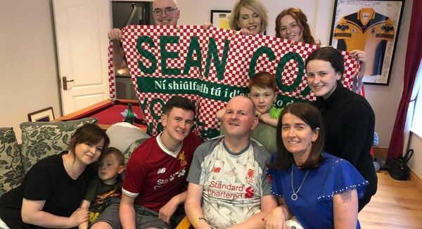 Sean Cox watching the 2019 Champions League final at home with his family.
