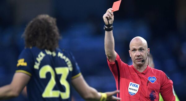 Referee Anthony Taylor shows Arsenal's David Luiz a red card in the 3-0 defeat by Manchester City. Photo: Peter Powell/PA Wire/NMC Pool