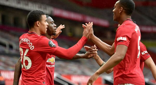 Manchester United's Mason Greenwood (left) celebrates scoring his side's fourth goal of the 5-2 win over Bournemouth.Peter Powell/NMC Pool/PA Wire.