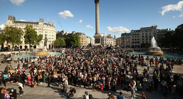 People gather in Trafalgar Square, London, after marching through central London, following a Black Lives Matter rally in Hyde Park, London. (Yui Mok/PA Wire)