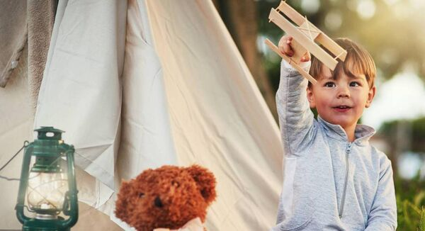 Outdoor fun can be as simple as hanging an old blanket from a tree for an instant teepee. Picture: iStock