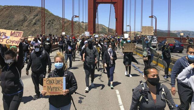 Dozens of people march across the Golden Gate Bridge in support of the Black Lives Matter movement in San Francisco last weekend.  Picture: AP/Jeff Chiu