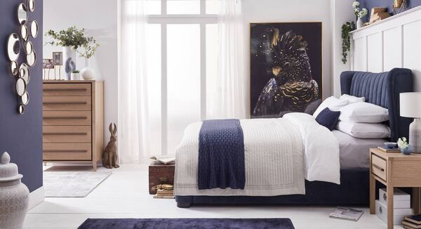 Here's how inviting a bedroom can be with an upholstered headboard on the Amelia bed frame (from €799), the Bubble mirror providing form and function (€139) and the parrot picture (€219). From Caseys.