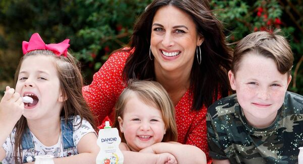 Lucy Kennedy pictured at home with her children Holly (8), Jess (3) and Jack (10), launching Danone Dairy. Picture: Andres Poveda