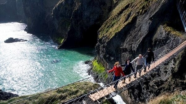 Traditionally fishermen erected the bridge to Carrick-a-Rede island over a 23m-deep and 20m-wide chasm to check their salmon nets. Today visitors are drawn here simply to take the rope bridge challenge!