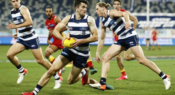 Mark O'Connor of the Cats runs with the ball during the round 5 AFL match between the Geelong Cats and the Gold Coast Suns at GMHBA Stadium on Saturday (Photo by Daniel Pockett/Getty Images)