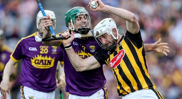 Wexford's Shaun Murphy and Conor Fogarty of Kilkenny (©INPHO/Gary Carr)
