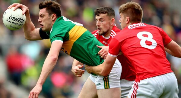 Kerry's David Moran is tackled by Nathan Walsh and Ian Maguire during last year's Munster final win over Cork at Páirc Uí Chaoimh. Picture: INPHO/James Crombie
