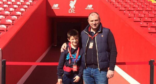Steven McDonnell with his son on a visit to Anfield. Both are passionate Liverpool fans.