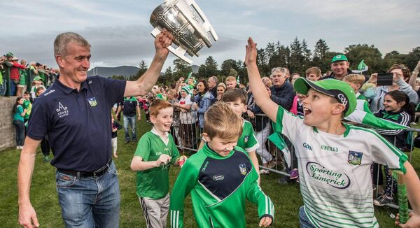 Limerick manager John Kiely bringing the Liam MacCarthy Cup back to his home town of Galbally in 2018. Photo: INPHO/James Crombie